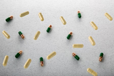pilule: Heap of colorful drugs and pills on textured background