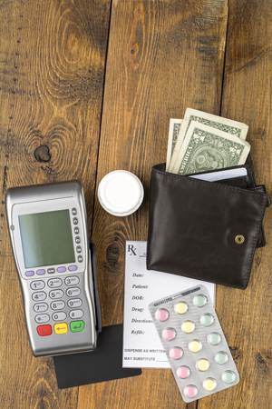 emergency cart: Pos terminal and leather wallet with paper money