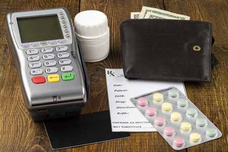 emergency cart: Payment wireless terminal and leather wallet with paper money Stock Photo