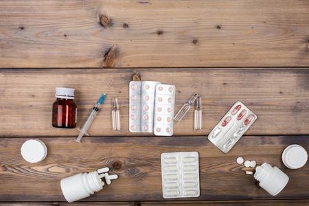 ampule: Medicine setup. Syringe and ampule on wooden background Stock Photo