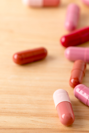 Scattered colorful medicine pills and capsules Stock Photo