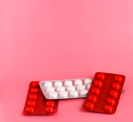 Red and white blister pack of white pills Stock Photo