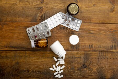 Pills white, blister pack and different medicine bottles Stock Photo
