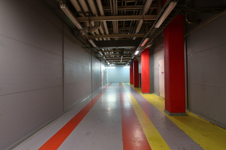 factory floor: Wide colorful corridor between shops on a large plant