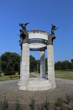 rotunda: Stone white rotunda decorated with little angels made of bronze