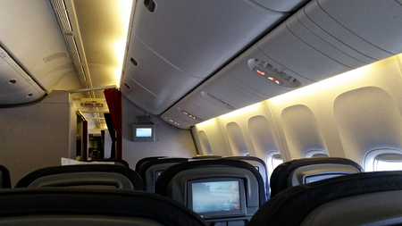 hangar: Empty cabin in a passenger plane at the time of parking in the hangar Stock Photo