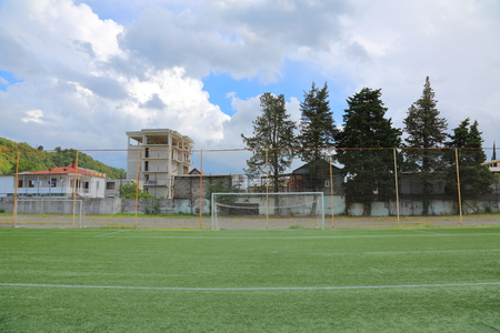 goalpost: Football soccer goal with the net at the stadium in the mountains Stock Photo