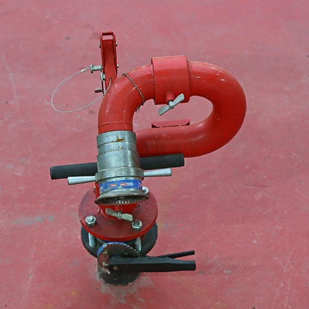 red metal: Red metal crane-pump to connect emergency fire hose