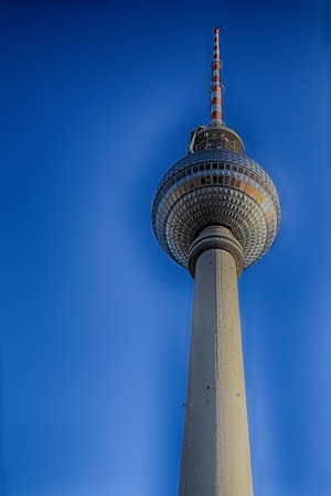 is cloudless: BERLIN, GERMANY - JANUARY 28, 2013: Part of a television tower with a ball and spire against the blue cloudless sky