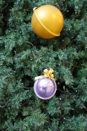 holiday garland: Green pine needles of the Christmas tree with colorful toys and electric holiday garland