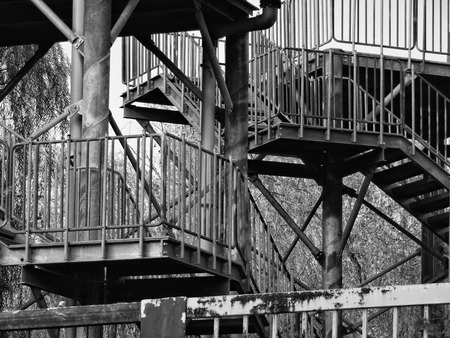 metal handrail: Black and white photo of metal stairs at the crossing road