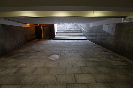 underground passage: The underground passage lined with gray granite and marble Stock Photo