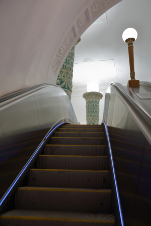 metallic stairs: Metallic color escalator with illuminated stairs in the subway in Moscow
