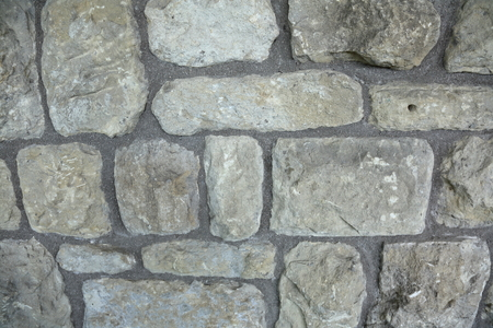 salient: Original textured surface of the wall salient natural stone