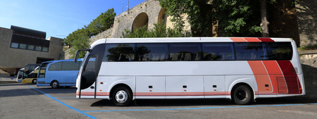 public transfer: Four comfortable tourist class bus in the parking lot in the summer