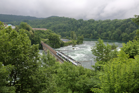 The Majestic River Rhine On The Swiss Territory Near The Waterfall - Swiss river to the rhine