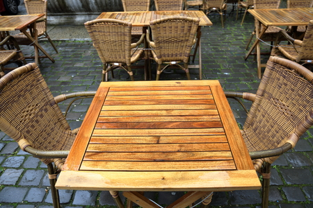 unoccupied: City european cafe with vacant table and chair waiting for the client