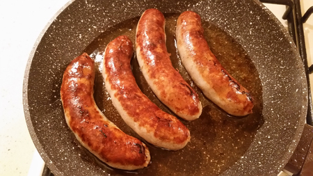 appetizing: Appetizing ruddy juicy sausages fried in a large frying pan