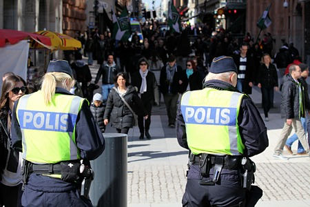 protesters: STOCKHOLM, SWEDEN - APRIL 14, 2013: Swedish police and protesters in the street of the capital city Editorial