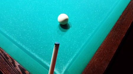 snooker tables: Ivory billiard ball on the green cloth of the table to play