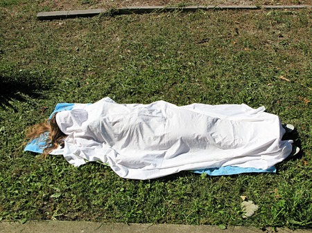 bedsheet: The body of a young blonde girl covered with a white bedsheet