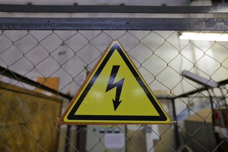 electric shock: The triangular yellow sign of the danger of electric shock