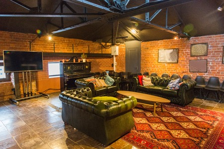 The idea of lounge design in the attic under the roof of the building