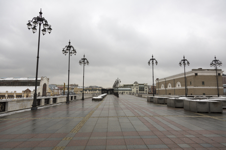 patriarchal: MOSCOW, RUSSIA - DECEMBER 25, 2016: Pedestrian Patriarchal bridge in cloudy weather