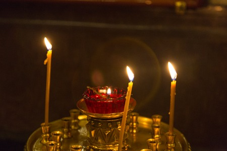 Wax candles on a floor candlestick in the Christian temple Stock Photo