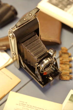 retractable: Old rarity metal photo camera with leather inserts