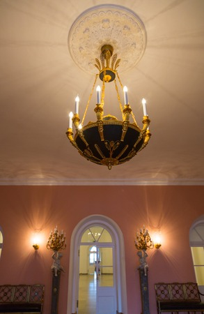 plafond: Old forged chandelier with multiple bright lamps Stock Photo