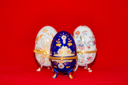 partake: Colorful festive easter egg on red background