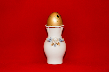 Colorful festive easter egg on red background