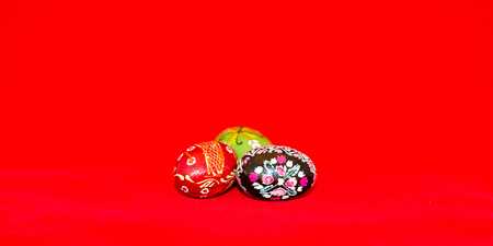 resurrect: Colorful festive easter egg on red background