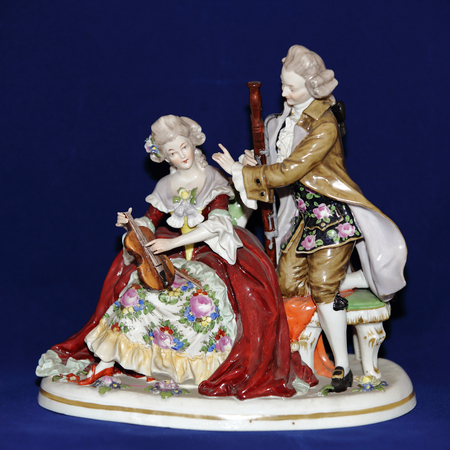 Miniature antique figurine from porcelain of the early 20th century Stock Photo