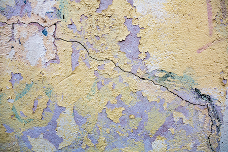 premises: Textured surface of an old cracked wall in the building