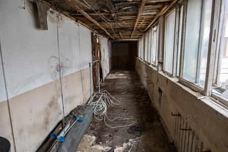 requiring: Ruined abandoned room in a house requiring major repairs