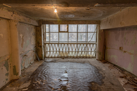 premises: Ruined abandoned room in a house requiring major repairs