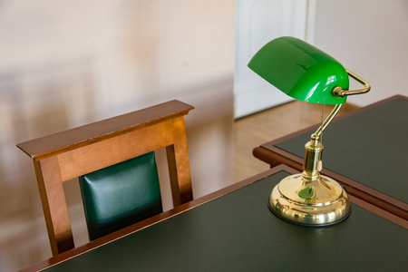 Tabletop gold-plated reading lamp with green lampshade