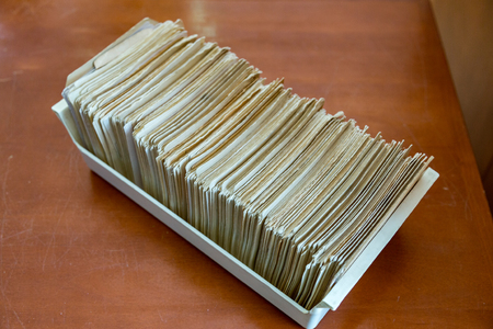 Paper cards for books and documents registration in the library catalog Stock Photo