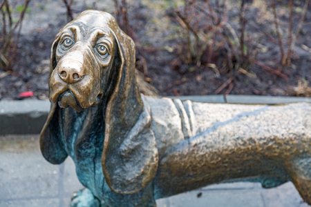KOSTROMA, RUSSIA - APRIL 27, 2017: Bronze sculpture to help the affected pets in the city center