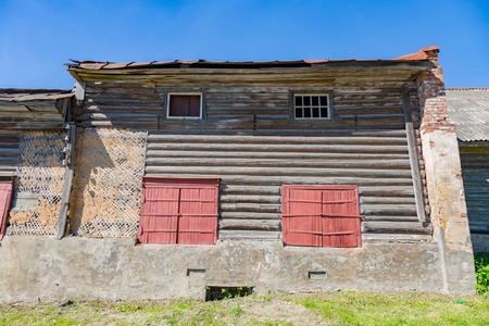unfit: Facade of an old destroyed house unfit for living Stock Photo