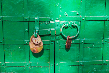 Old iron lock in rust hanging on metal hinges Stock Photo