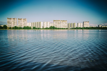 storey: A large multi-storey building on the outskirts of the city. View from the Moscow River