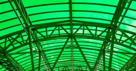 Green construction of the steel beams and metal pipes Stock Photo