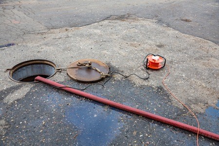 Repair of sewage leakage with an electric pump Imagens
