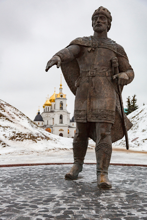 DMITROV, RUSSIA - DECEMBER 12, 2017: Monument to Yuri Dolgoruky against the background of the Assumption Cathedral. Established in 1954