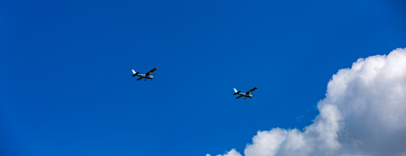 Two airplane flying in the blue sky with cloud