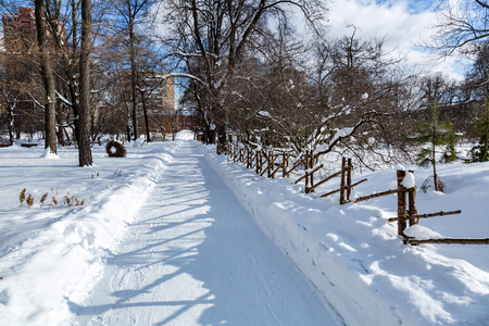 Trampled path for walking pedestrians in a snowbound winter city park Stock Photo