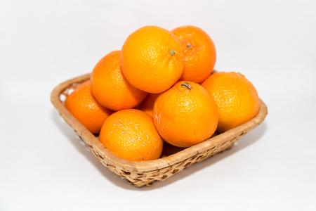 Few appetizing orange mandarins in a wicker basket Reklamní fotografie